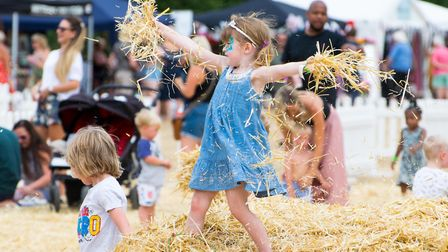 Children playing in the hay at the first Todd in the Hole Festival. Picture: Todd in the Hole