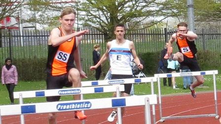 SNHAC's Freddie Reilly (left) and Joel Evans (right) flank Stevie Kasparis (Eastbourne) in the 400m