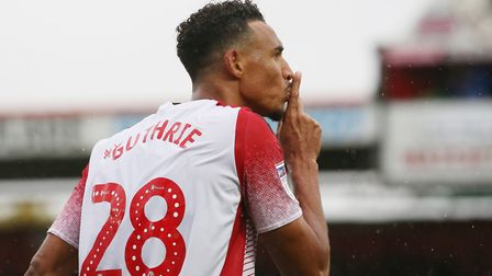 Kurtis Guthrie of Stevenage celebrates his goal by gesturing to the Colchester United fans in the Le
