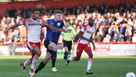 Luther Wildin of Stevenage bursts onto a loose ball and into the box but shoots over the bar in the