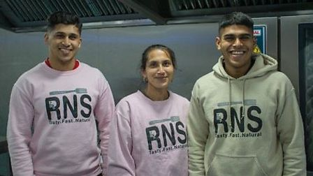 Simmy (right) with brother Jhai (left) and their mum in the Rice n Spice kitchen. Picture: Rice n Sp