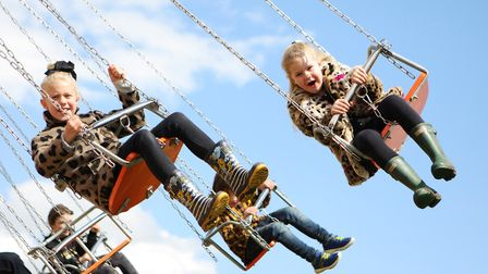 Stotfold Mill Steam Fair 2019 - Sadie, 8, and Betsy, 6, enjoy the fairground ride.Picture: Karyn