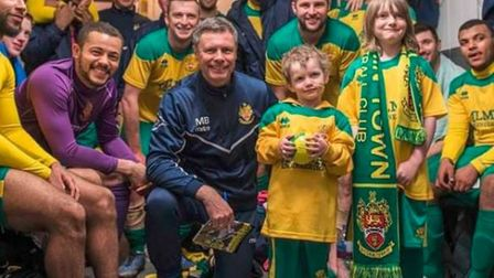 Seraph with the Hitchin Town squad in the dressing room after their Team Super Seraph day. Picture: