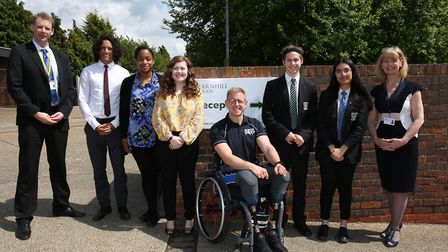 Paralympian wheelchair rugby player Aaron Phipps with (L-R) head of sixth form Ed Dixon, year 13 and