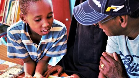 Kenyan children enjoy some books in one of Just Be A Child's libraries. Picture: Lenka McAlinden.