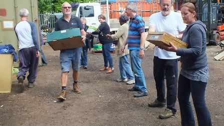 Volunteers worked together to pack last year's shipping container. Picture: Lenka McAlinden.