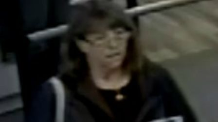 Police have released CCTV images of a woman they want to speak to in connection with a purse theft i