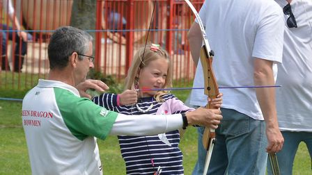 Children had a go at archery at Walsworth Festival. Picture: Alan J Millard