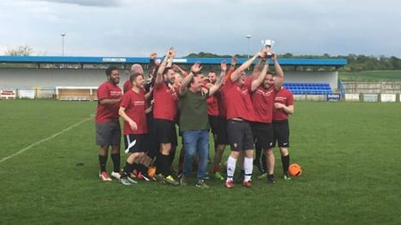 Ben Cole XI celebrate on the pitch after winning the Mitchell Cole Memorial Tournament. Picture: Kei