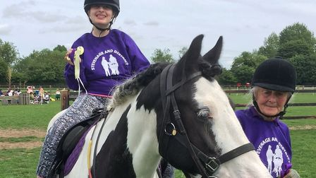 An RDA rider and volunteer at a competition. Picture: RDA