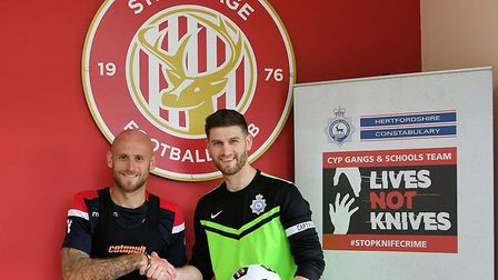 Stevenage FC captain Scott Cuthbert and Herts Police captain Andy Plant. Picture: Herts Constabulary