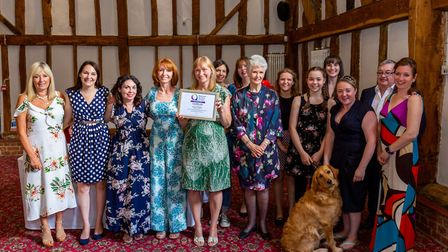 TRACKS Autism's principal Jane Wagstaff-Smith (holding certificate), with the charity's president Ja