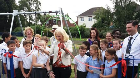 Sharon Taylor, Leader of the Council, opens the park with pupils from Woolenwick Junior. Picture: SB