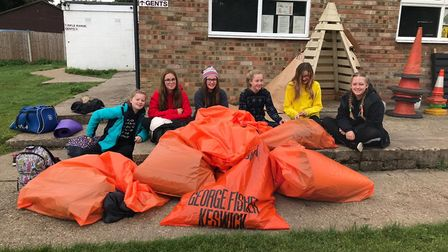 The girls slept outside all night to raise money for Feed Up Warm Up. Picture: Mathew Jones