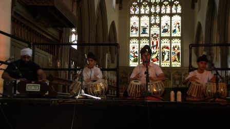Sukhi Rayat, pictured performing in St Mary's Church as part of Rhythms of the World 2013, is among