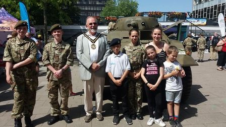 Stevenage mayor Simon Speller with army cadets and community members in front of the American tank.