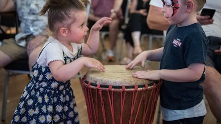 Two youngsters have a djemba drum off at Rhythms of the World in Hitchin. Picture: Peter Alan Gill