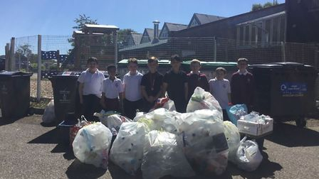 Pupils collected more than 10,000 items of plastic, shown here in bags as well as in the bins behind