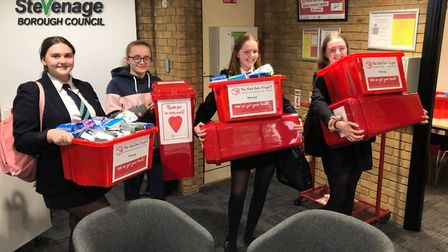 Members of Stevenage Youth Council helped deliver Red Box Project donations and donation bins to sch