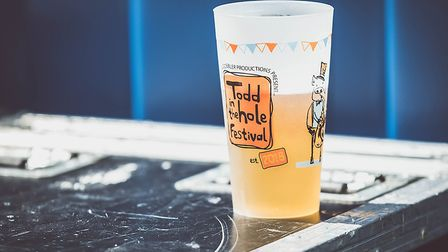 Cheers! Having a beer at Todd in the Hole Festival. Picture: Martin Wootton