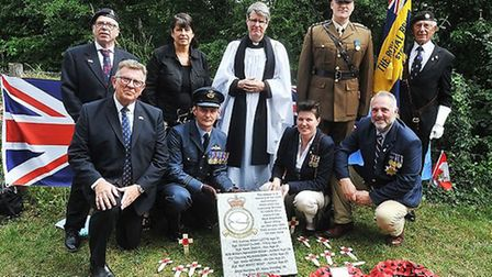 The day's attendees pose with the new memorial. Picture: Alan Millard