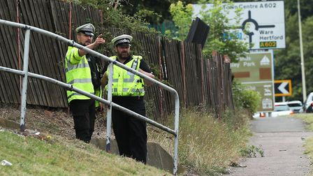 Police at the scene in Monkswood Way in Stevenage the morning after the crash. Picture: YUI MOK/PA