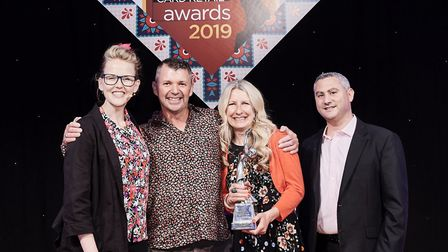 Cardies co-owners Andrew McReynolds and Jo Sorrell (centre) accept their award from Daniel Prince, m