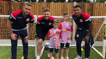 Dean Parrett, Ben Kennedy and Tyler Denton surprise local fans with some goodies. Picture: Stevenage