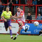 Paul Taylor of Stevenage forces Lewis Ward of Exeter City into great save during Stevenage vs Exeter