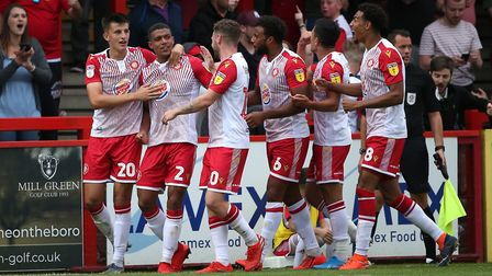 Luther Wildin (second from left) is congratulated after scoring a sensational goal in Stevenage's 2-