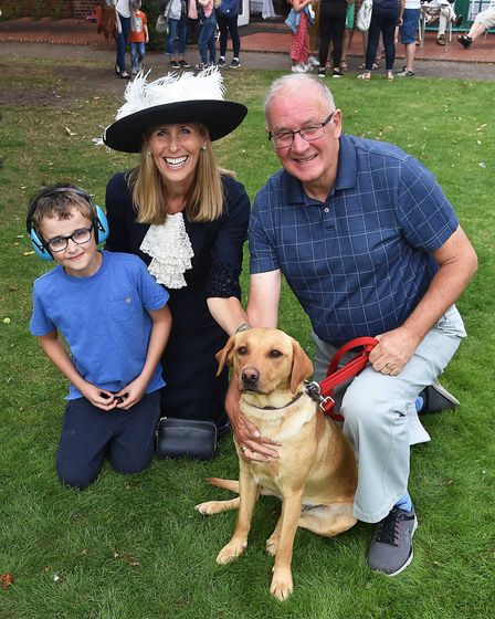 Spider the therapy dog with Byron Houghton (left) High Sheriff and Chairman Ian Cotterill. Picture: