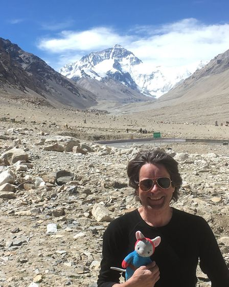 Richard Barr and Tom Mouse reach their destination of Mount Everest after motorcycling for three and