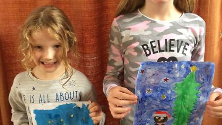 Orla Philpotts and Shye Donovan with their winning designs. Picture courtesy of Paul Sear.