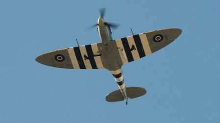 Spitfire Vb AB910 from the Battle of Britain Memorial Flight performed three graceful flypasts. Pict