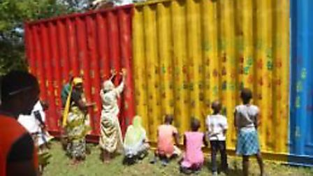 Villagers decorated the shipping container with colourful handprints. Picture: Lenka McAlinden.