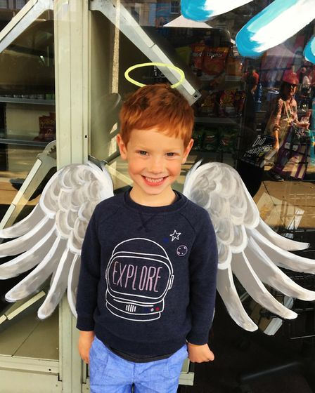 Arnaud Cox, aged 5, posing in front of the children sized wings. Picture: Clara Nicoll