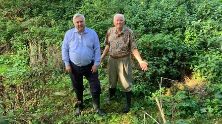 MP for North East Herts Sir Oliver Heald standing on the dry riverbed with County Councillor Michael