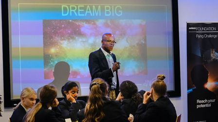 Olympian Kriss Akabusi gives a motivational speech to students at The Thomas Alleyne Academy during
