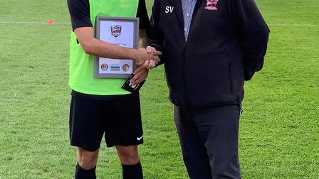 Charlie Cole receives the September player of the month award from Stuart Vant