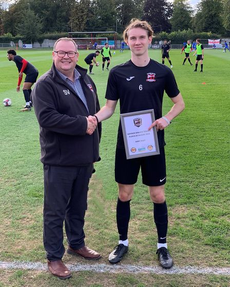 Jamie Riley receives the August player of the month award from Stuart Vant