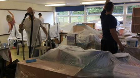 Teams of volunteers worked round the clock to get the school ready for the new term. Picture: Liz Ty