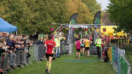 Standalone 10k: Runners crossing the line at Letchworth's Standalone Farm. Picture: Ollie Saville
