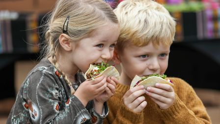 Freya, four, and Flynn Christensen, six, tuck into their tacos. Picture: DANNY LOO
