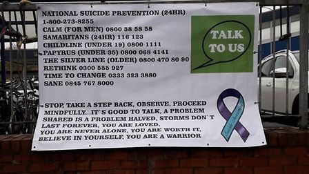 Banners have been put up at railway stations in a bid to help people with mental health issues.