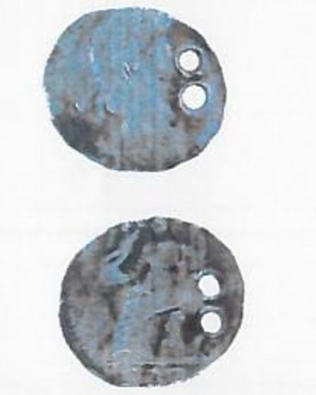 The double pierced Roman silver coin is dated AD 395-402
