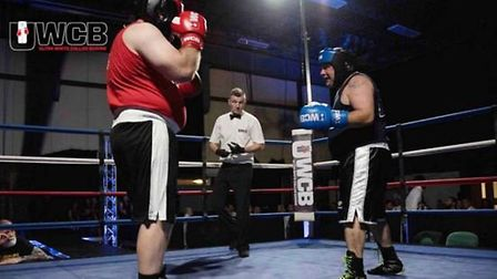 George Joyce (right) takes on his opponent in the ring. Picture: UWCB.