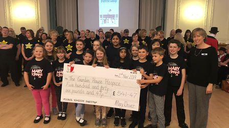Children from the William Ransom School presented a cheque to at the Garden House Hospice Care Stric