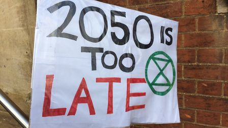 Climate campaigners made a stand outside Hitchin Town Hall yesterday. Picture: Jacob Savill