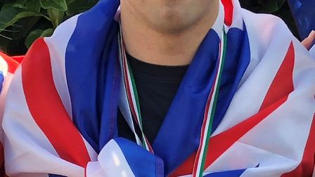 Mark Evens, 22, won gold and set new world records at the 5th European Down Syndrome Swimming Champi