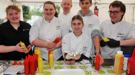 North Herts College students prepare the sausages at Baldock's second annual Oktoberfest. Picture: A